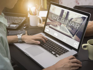 Laptop with webinar illustrating the hii retail cloud solution webinar.