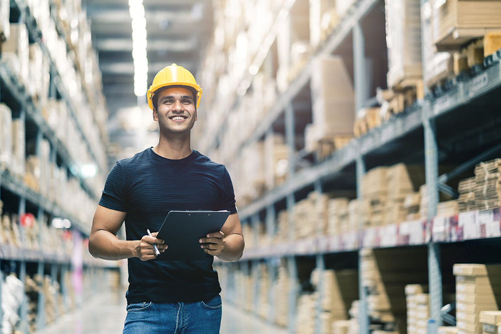Smiling guy in warehouse doing workforce planning